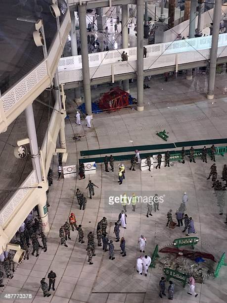 Saudi emergency teams gather inside the Grand Mosque of Saudi Arabia's holy Muslim city of Mecca after a construction crane crashed into it on...