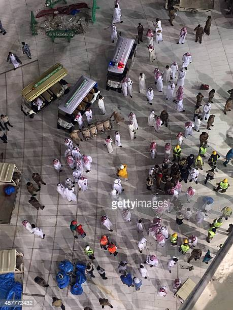 Saudi emergency teams stand inside the Grand Mosque of Saudi Arabia's holy Muslim city of Mecca after a construction crane crashed into it on...