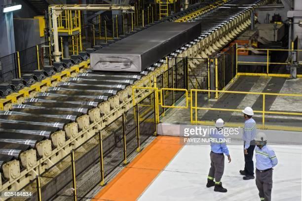 Saudi employees observe an aluminium production line at the Maaden Aluminium Factory in Ras AlKhair Industrial area near Jubail City 570 kms east of...