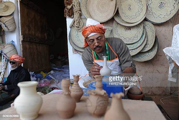 A Saudi exhibitor shows his skills during the Janadriyah festival of Heritage and Culture held in the Saudi village of AlThamama 50 kilometres north...