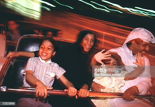 Saudi family enjoy a high speed fun fair ride despite tensions caused by the build up to the first Gulf War
