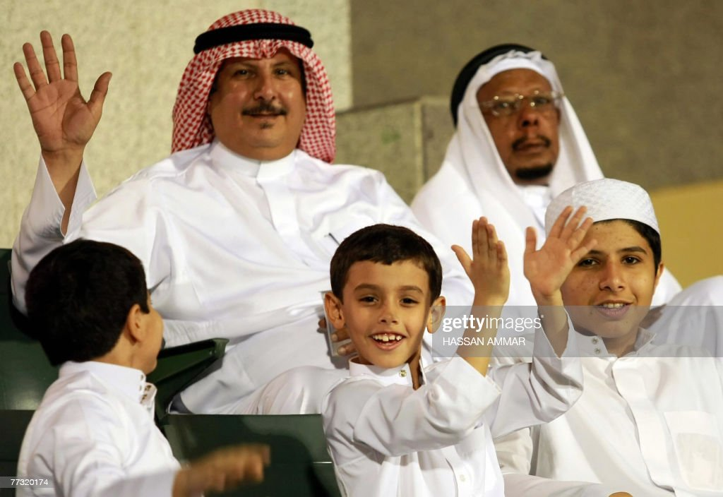 A Saudi family enjoy the celebration of Eid al-Fitr, which marks the end of Ramadan and the beginning of a three-day festival, at Prince Faisal bin Fahd stadium in Riyadh, late 12 October 2007. Piety, defiance and bloodshed marked the feast of Eid al-Fitr, ending the holy month of Ramadan, across much of the Middle East.