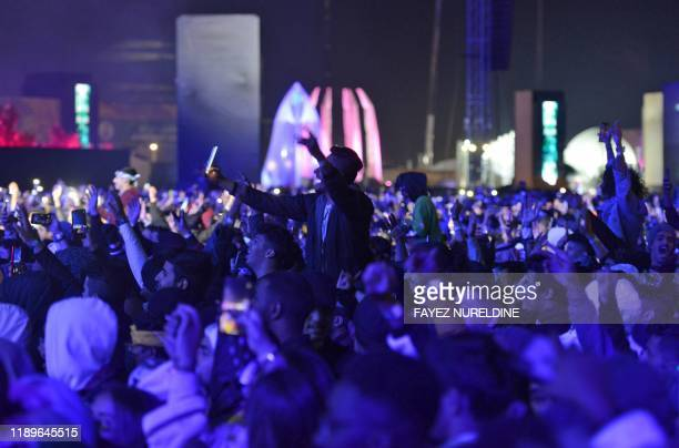 Saudi fans attend the MDL Beast Fest an electronic music festival held in Banban on the outskirts of the Saudi capital Riyadh on December 19 2019...