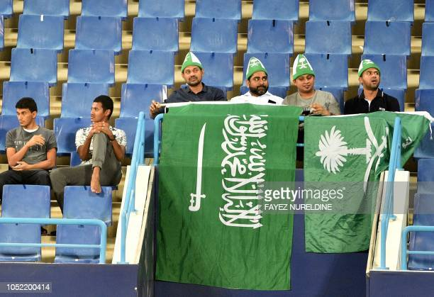 Saudi fans cheer during a friendly football match between Saudi Arabia and Iraq for the Superclassico championship at King Saud University Stadium in...