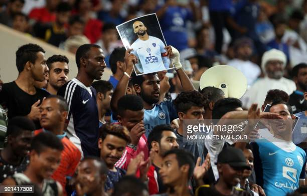Saudi fans cheer during the Asian Champions League football match between Saudi club AlHilal and Iranian club Esteghlal on February 20 2018 at alSeeb...