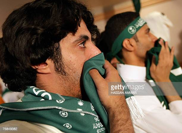 Saudi football fans react after their national team lost for Iraq the final match of the Asian Football Cup 2007 in Riyadh 29 July 2007 Skipper...