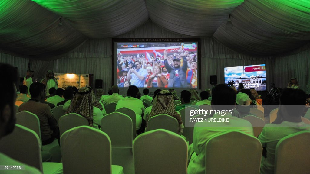 TOPSHOT - Saudi football fans watch the Russia 2018 World Cup Group A football match between Russia and Saudi Arabia at a fan tent in the capital Riyadh on June 14, 2018.