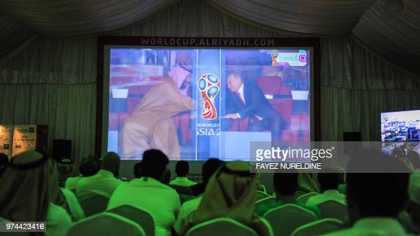 TOPSHOT Saudi football fans watch the Russia 2018 World Cup Group A football match between Russia and Saudi Arabia at a fan tent in the capital...