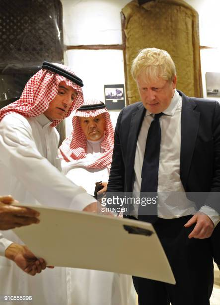 Saudi Foreign Minister Adel alJubeir and his British counterpart Boris Johnson tour the Nassif House in the historic quarter of Jeddah on January 25...