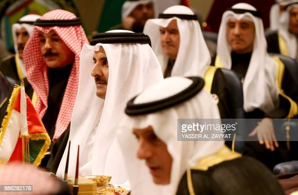 Saudi Foreign Minister Adel alJubeir and Qatar's Emir Sheikh Tamim bin Hamad alThani attend the Gulf Cooperation Council summit at Bayan palace in...