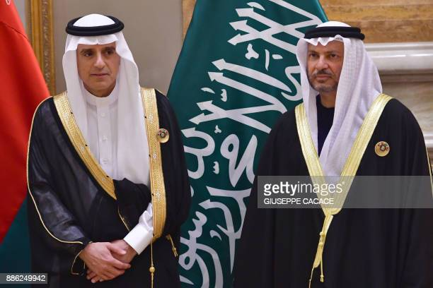 Saudi Foreign Minister Adel alJubeir and UAE Minister of State for Foreign Affairs Anwar Gargash are seen posing for a family picture at the Gulf...