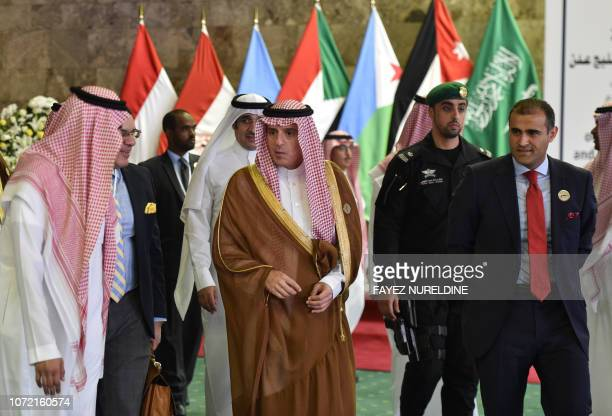 Saudi Foreign Minister Adel alJubeir and Yemen's Deputy Foreign Minister Mohammed Hadrami arrive to attend a meeting of foreign ministers of...