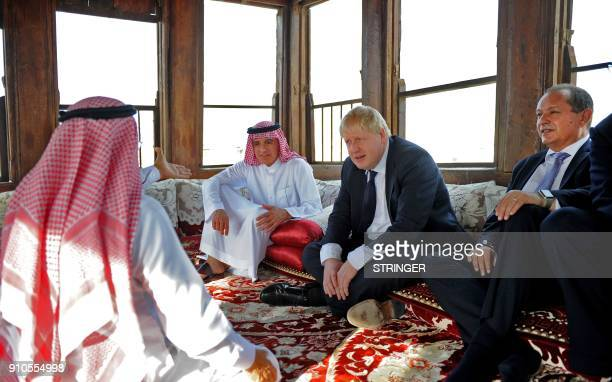 Saudi Foreign Minister Adel alJubeir sits with his British counterpart Boris Johnson as they tour the Nassif House in the historic quarter of Jeddah...