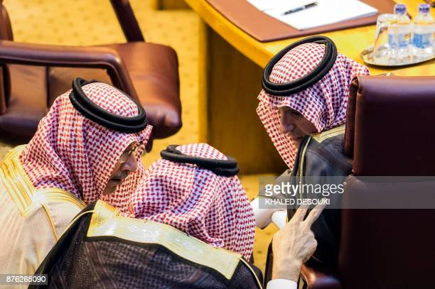 Saudi Foreign Minister Adel alJubeir speaks with members of the Saudi delegation during a meeting at the Arab League headquarters in the Egyptian...