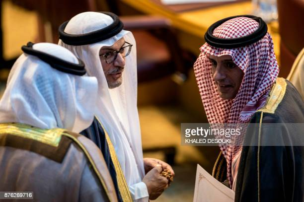 Saudi Foreign Minister Adel alJubeir talks with UAE Minister of State for Foreign Affairs Anwar Gargash during a meeting at the Arab League...