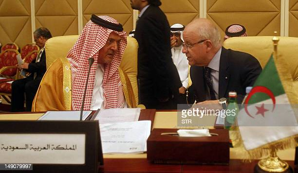 Saudi Foreign Minister Prince Saud alFaisal speaks to his Algerian counterpart Mourad Medelci during the Arab League ministerial meeting on the...