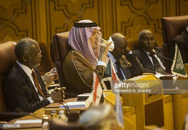 Saudi Foreign Minister Prince Saud alFaisal takes a drink during a meeting of foreign ministers at the headquarters of the Arab League in the...