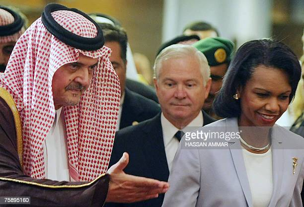 Saudi Foreign Minister Saud al Faisal shows the way to US Secretary of State Condoleezza Rice and Defence Secretary Robert Gates prior a joint press...