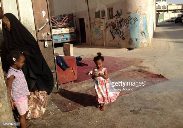 Saudi girl stands outside her home where she and her family live in squalor in a neighborhood of south Riyadh Saudi Arabia March 1 2013 Like many...