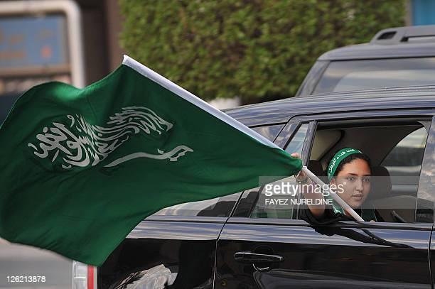 A Saudi girl waves a national flag during celebrations of the 81st Saudi Arabian National Day in the desert kingdom's capital Riyadh on September 23...
