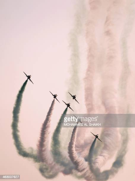 Saudi Hawks display team perform during the opening of the Bahrain International Airshow 2014 in Sakhir south of the capital Manama on January 16...