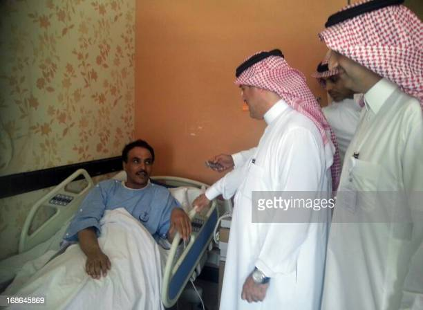 Saudi health ministry official visits patients infected with a new SARSlike virus at a hospital in the eastern Saudi province of alAhsaa on May 13...