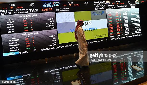 A Saudi investor monitors the stock exchange at the Saudi Stock Exchange or Tadawul on December 14 2016 in the capital Riyadh / AFP / FAYEZ NURELDINE