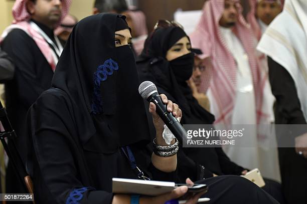 Saudi journalist Munira alMshakhes asks questions during a press conference by Syrian former prime minister and newlyelected general coordinator for...