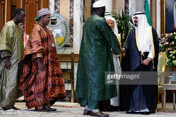 Saudi King Abdullah bin Abdul Aziz alSaud shakes hands with African Muslim delegates attending at the International Islamic Conference in the holy...