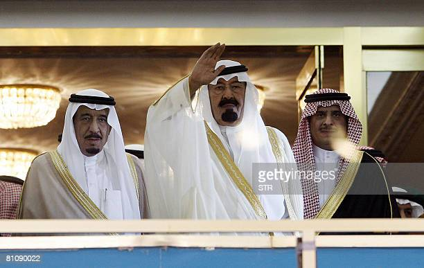 Saudi King Abdullah bin Abdul Aziz alSaud waves to the crowd as he attends the final football match for the King Abdullah Cup between alShabab and...