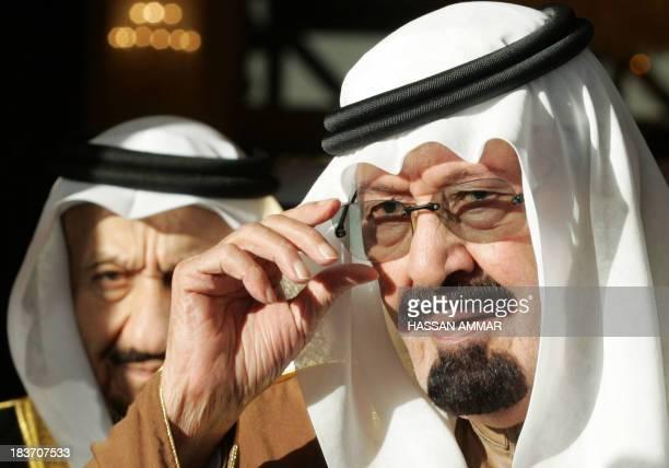 Saudi King Abdullah bin Abdul Aziz and Prince Miteb bin Abdul Aziz alSaud leave the airport after greeting Iranian President Mahmoud Ahmadinejad in...