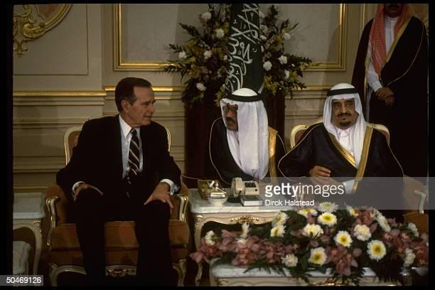 Saudi King Fahd sitting w Pres Bush discussing gulf crisis w translator at C