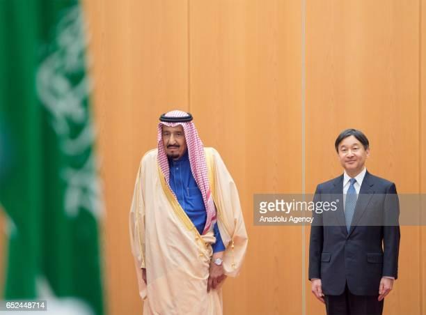 Saudi King Salman bin Abdulaziz Al Saud is welcomed by Crown Prince of Japan Naruhito upon his arrival at Haneda Airport in Tokyo Japan on March 12...
