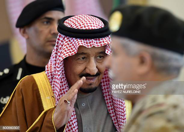 Saudi King Salman bin Abdulaziz greets military officers ahead of his meeting with Emir of Kuwait upon the latters arrival to attend the 136th Gulf...