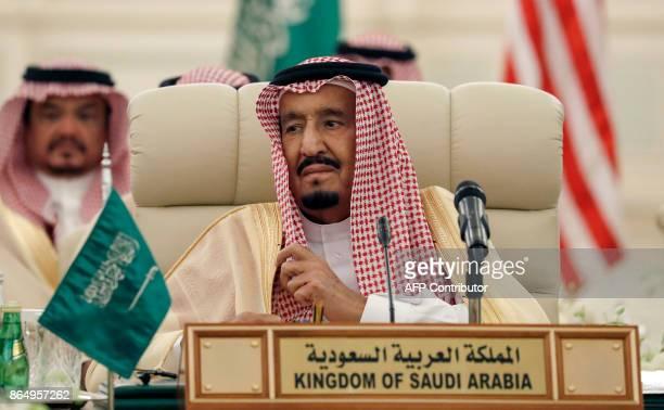 Saudi King Salman bin Abdulaziz listens during a meeting of the SaudiIraqi Bilateral Coordination Council in the capital Riyadh on October 22 2017 /...
