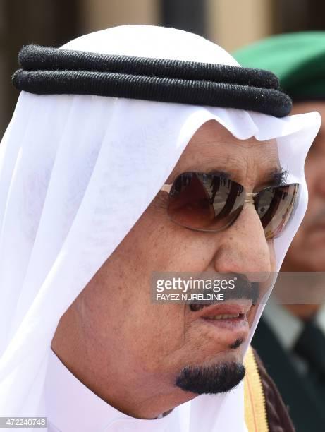 Saudi King Salman bin Abdulaziz looks on during the welcoming ceremony for Qatar's Emir Sheikh Tamim bin Hamad AlThani upon his arrival in Riyadh to...