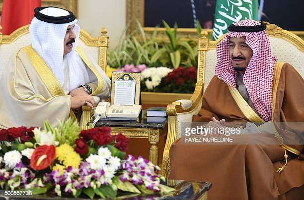 Saudi King Salman bin Abdulaziz talks to Bahraini King Hamad bin Isa alKhalifa upon the latters arrival to attend the 136th Gulf Cooperation Council...