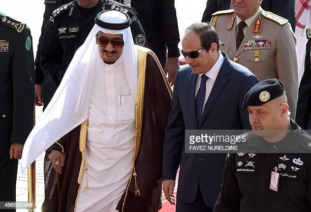 Saudi King Salman bin Abdulaziz welcomes Egyptian President Abdel Fattah alSisi at Riyadh international airport on November 10 as Arab leaders and...