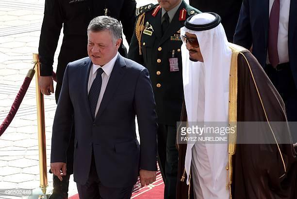 Saudi King Salman bin Abdulaziz welcomes his Jordanian counterpart King Abdullah II at King Khalid International airport in Riyadh on November 10...