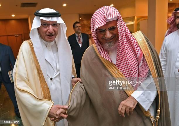 Saudi King' Salman bin abdulazziz advisor and Grand mosque Imam Saleh bin Hmaid shakes hands with OIC Secretary ~General Yousef Bin Ahmed AlOthaimeen...