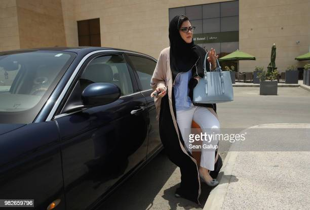 Saudi lawyer and businesswoman Sofana Dahlan perpares to get in her car after going for coffee to a cafe on the first day she is legally allowed to...