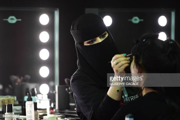 A Saudi makeup artist preps a model backstage during the first Arab Fashion Week in Riyadh on April 13 2018 Arab Fashion Week is taking place at...