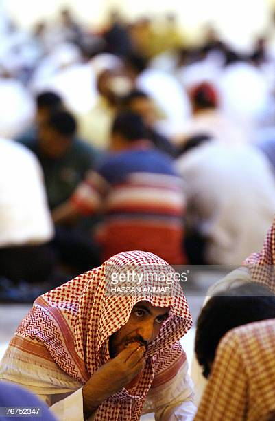 A Saudi man breaks his fast on the first Friday of Ramadan at the Imam Turki bin Abdullah mosque in Riyadh 14 September 2007 The world's 12 billion...