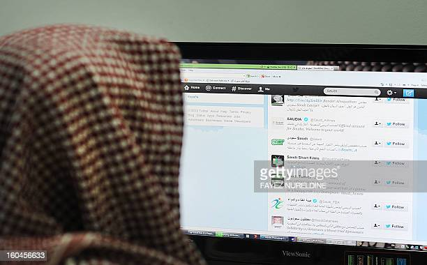 A Saudi man browses through twitter on his desktop in Riyadh on January 30 2013 Twitter's unmatched platform for public opinion is emboldening Gulf...