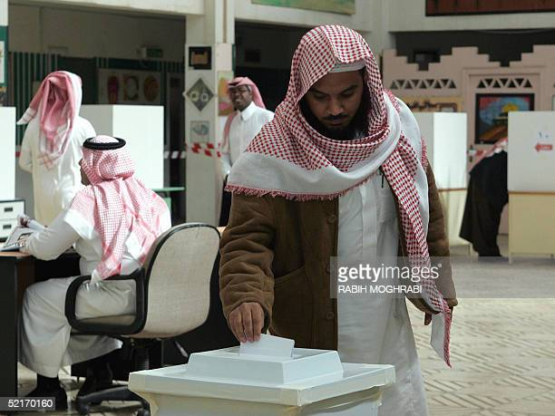 Saudi man casts his vote at a polling station in Riyadh 10 February 2005 Saudi men went to the polls in the country's first ever election a municipal...