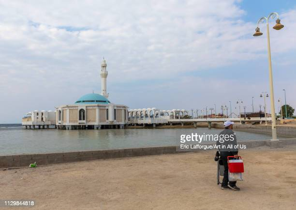 Saudi man holding a cooler in front of the floating mosque or masjid Bibi Fatima Mecca province Jeddah Saudi Arabia on December 14 2018 in Jeddah...