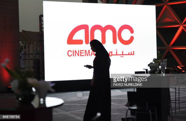 A Saudi man holds his cellphone during a cinema test screening in Riyadh on April 18 2018 Blockbuster action flick 'Black Panther' play at a cinema...