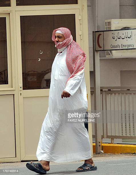 A Saudi man leaves the emergency section in King Fahad hospital in the city of Hofuf 370 kms East of the Saudi capital Riyadh on June 16 2013 Four...