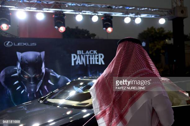 A Saudi man looks at a car during a cinema test screening in Riyadh on April 18 2018 Blockbuster action flick 'Black Panther' play at a cinema test...