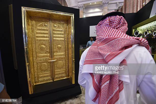 A Saudi man looks at a replica of the golden doors of the Kaaba in the holy city of Mecca displayed during the 2016 World Luxury Expo Riyadh 2016...